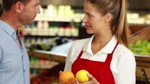 communication : Customer and worker discussing fruit in high quality 4k format Stock Footage