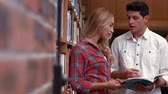 campus : Students talking in the library at the college Stock Footage