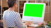 mouse : Casual businesswoman using computer with green screen in 4k
