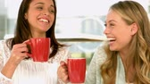 strong tea : Pretty girls drinking and laughing in slow motion