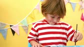 slowmotion : Happy boy using a paint brush in slow motion