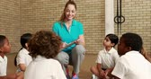 caucasian : Pupils and teacher during sports lesson at the elementary school Stock Footage