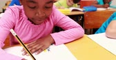 caucasian : Cute little girl drawing with pencil in class Stock Footage