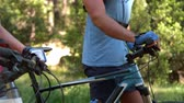 caucasian : Happy couple with bikes in the countryside Stock Footage