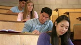 caucasian : Close up view of students working in college Stock Footage