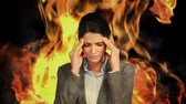 caucasian : Stressed businesswoman with headache on flaming background Stock Footage