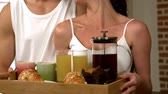 caucasian : happy young couple taking breakfast in the kitchen Stock Footage