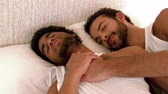caucasian : Gay couple relaxing in the bed at home