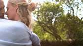 slowmotion : Adult couple hugging and embracing outdoors Stock Footage