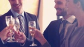 holding : Business team toasting with champagne in slow motion