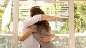 definition : Couple hugging in new home in slow motion Stock Footage