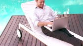 decking : Man using laptop in the garden in slow motion
