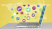 popping : Colorful icons popping up by laptop against yellow planetary Stock Footage