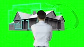 ön plan : Rear view of architect designing house on green interface Stok Video