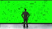 finding : Rear view of businessman looking at green interface Stock Footage