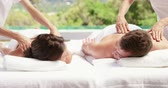 массажист : Couple receiving a back massage in slow motion