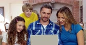adult : Happy family using laptop on the sofa Stock Footage