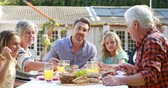 happy : Happy family eating lunch outdoor Stock Footage