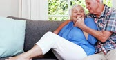 livingroom : Senior couple talking in sitting room at home Stock Footage