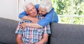 conversation : Senior couple talking in sitting room at home Stock Footage