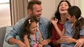 life : Happy family playing together on the sofa in slow motion Stock Footage
