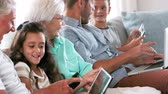 life : Cute family using electronic devices on the couch in slow motion