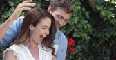 uncovering : Happy man giving present to surprised wife in slow motion