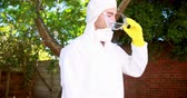 pesticide : Man doing pest control outside the house Stock Footage