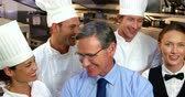 confident : Portrait of smiling chefs in the kitchen Stock Footage