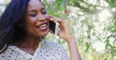 communication : Portrait of woman is smiling and talking on the phone in the garden