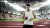 warming : Male athlete preparing to throw shot put ball in the a stadium Stock Footage