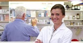 dispanser : Portrait of pharmacist standing with arms crossed in pharmacy Stok Video