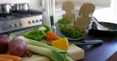 spring onion : Bowl of salad and fresh vegetables kept on kitchen worktop at home 4k