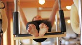 фитнес : Woman performing stretching exercise in fitness studio