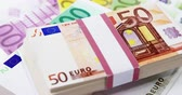 feixes : Bundle of 50 and 100 euro dollar on table
