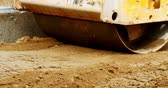 machinery : Road roller leveling ground at construction site Stock Footage