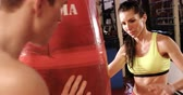 postura : Female boxer practicing with trainer at fitness studio Stock Footage