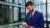 lifestyle : Businessman using digital tablet in office