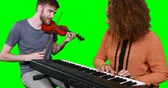 against : Musicians playing piano and guitar against green screen