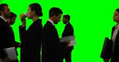 against : Businesspeople walking and doing various activities against green screen