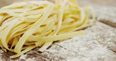 ingredient : Close-up of tagliatelle pasta on wooden background