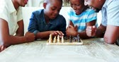 livingroom : Family playing chess together at home in the living room at home Stock Footage