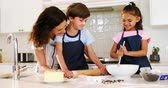 bowl : Mother and kids preparing cookies in kitchen at home