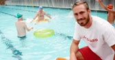 bóia : Swim coach standing with whistle and inflatable floater near swim pool