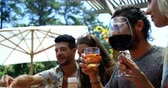 sauce pool : Group of friends enjoying the drinks at outdoors barbecue party near pool Stock Footage