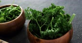 kereviz : Bowls of shredded cabbage and herbs on concrete background Stok Video