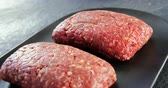ground meat recipes : Minced beef served on black tray on concrete background Stock Footage
