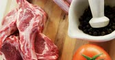 cooking : Close-up of beef rib chops and ingredients on wooden floor