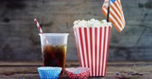 tatarak : Popcorn, confectionery and drink on wooden table with 4th july theme