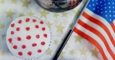 tatarak : Close-up of drink and cupcake with 4th july theme on table